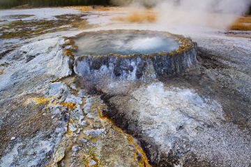 Hotspring and surrounding bacteria, Yellowstone National Park, Wyoming, USA. September 2008.