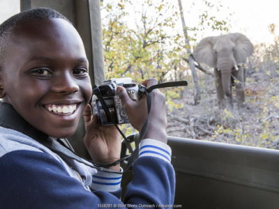 Vuthlare Nyathi, Wild Shots Outreach student from Mabine Primary School, photographs an inquisitive African elephant (Loxodonta africana) on her first ever game drive in the Greater Kruger National Park with Sefapane Lodges and Safaris. Greater Kruger National Park, South Africa, August 2016.