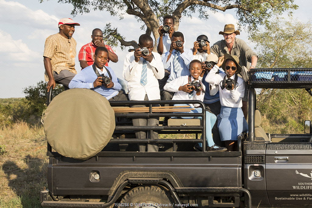 Wild Shots Outreach students from Phendulani Secondary School, Acornhoek, Limpopo on their first game drive with Wild Shots Outreach founder and director, Mike Kendrick. Location: Southern African Wildlife College, Kruger National Park, South Africa. February 2016.