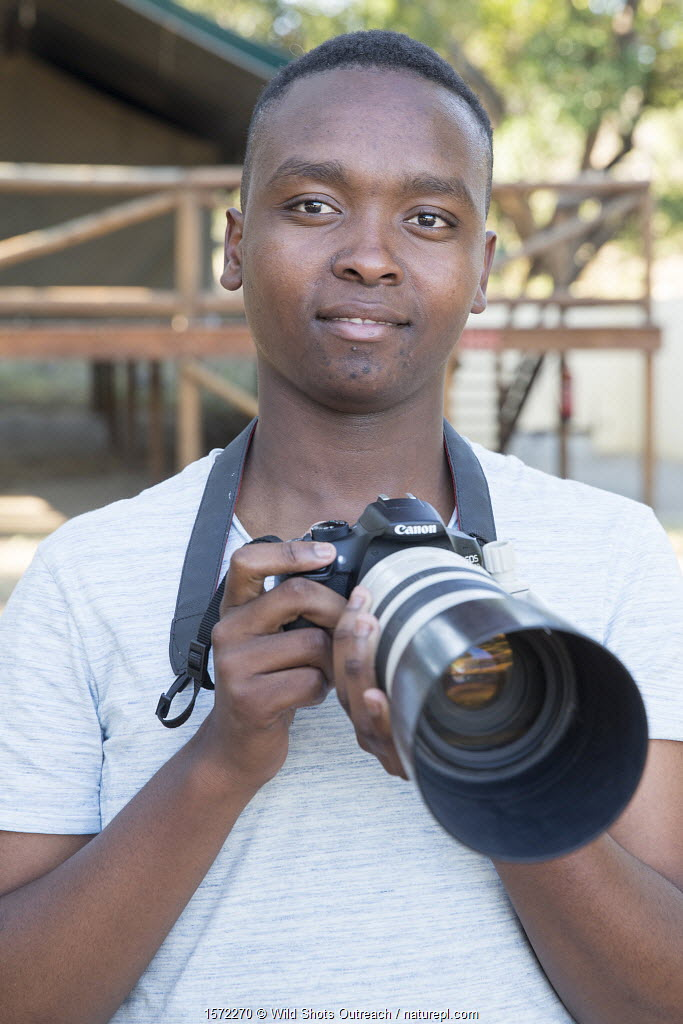 Pupil Israel Morei with DSLR camera during residential photography course organised by Wild Shots Outreach. Kruger National Park, South Africa, June 2017.