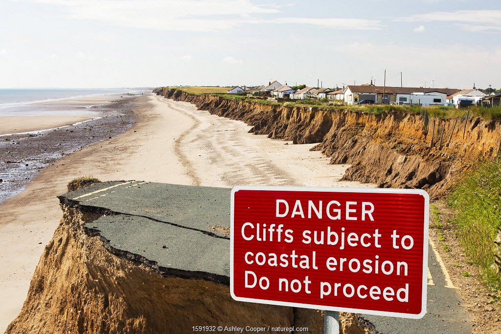 Collapsed coastal road near Skipsea, Yorkshire, England, UK. August 2013.