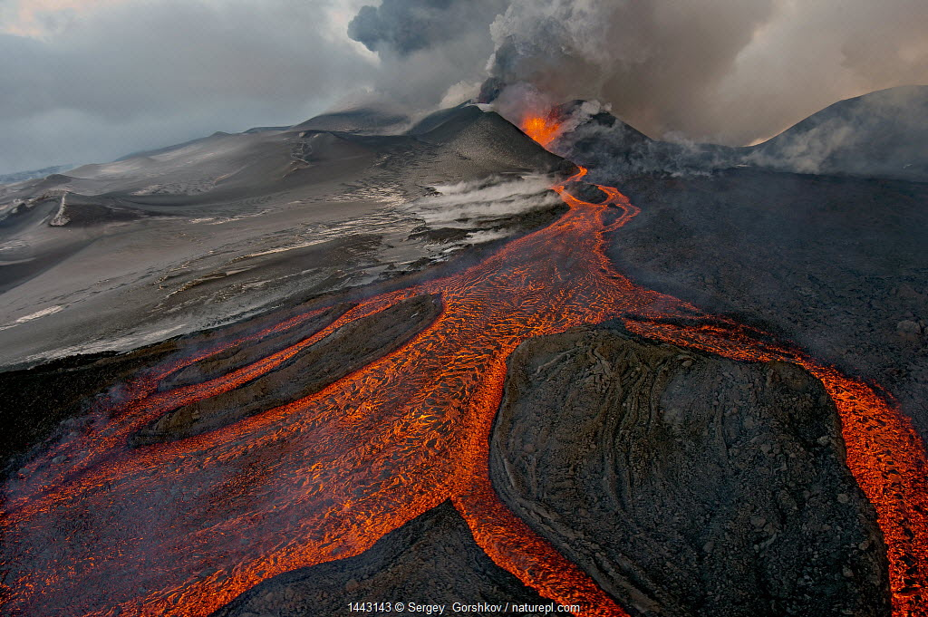 Tolbachik Volcano erupting with lava flowing down the mountain side. Kamchatka, Russia.