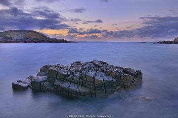 View from Altweary Bay to Melmore Head, Rosguill Peninsula at dusk, County Donegal, Republic of Ireland.