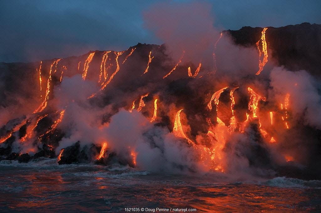 Red hot lava from Kilauea Volcano flowing into ocean at West Kailiili, Hawaii Volcanoes National Park, Big Island, Hawaiian Islands, USA.
