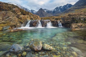Fairy Pools with Black Cuillin mountains in background, Isle of Skye, Inner Hebrides, Scotland, UK.