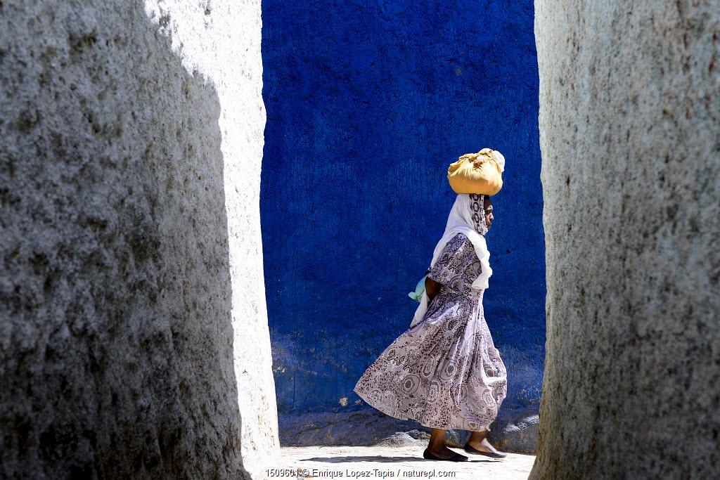 Women walking through the colourful narrow streets of Harar, Ethiopia