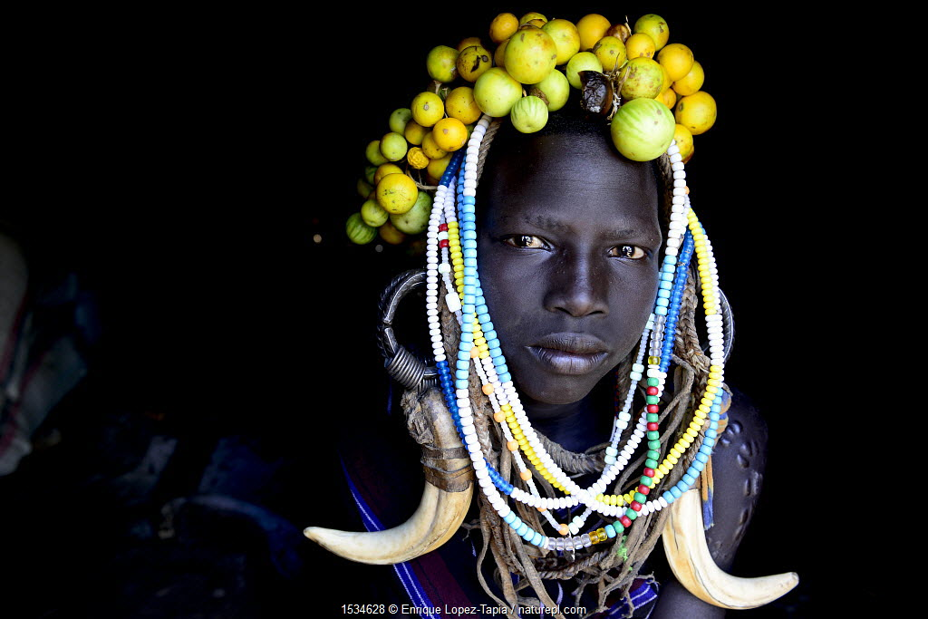 Young girl wearing traditional headdress. Mursi tribe, Mago National Park. Omo Valley, Ethiopia.
