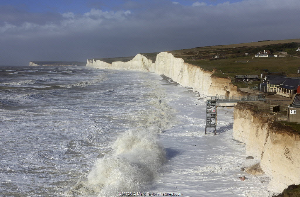 Waves crashing against chalk cliffs during a winter storm at Birling Gap, Sussex, England, UK, 15th February 2014.