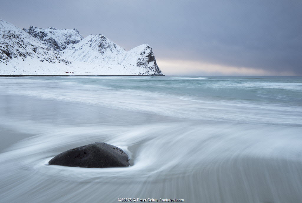 Waves washing on shore at twilight, Unstad beach, Unstad, Utakleiv, Haukland, Norway, March 2013.