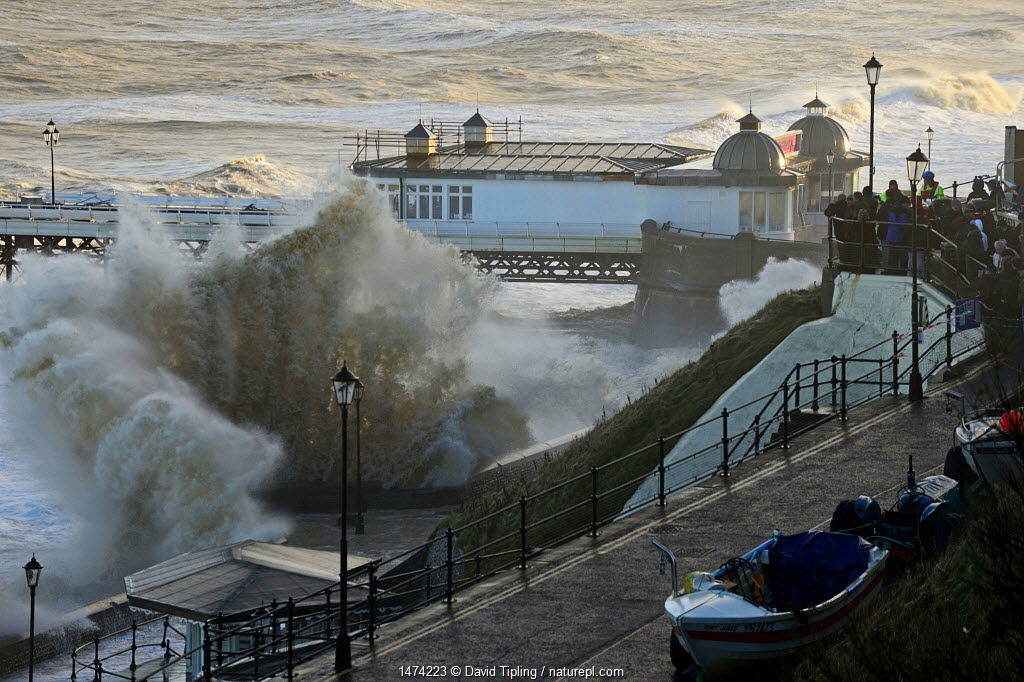 High waves lashing Cromer seafront and pier during storm surge., Norfolk, England, UK. December 2013.