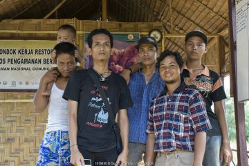 Sumatran Orangutan Society Staff, Rainforest Rehabilitation Team. North Sumatra, Indonesia.