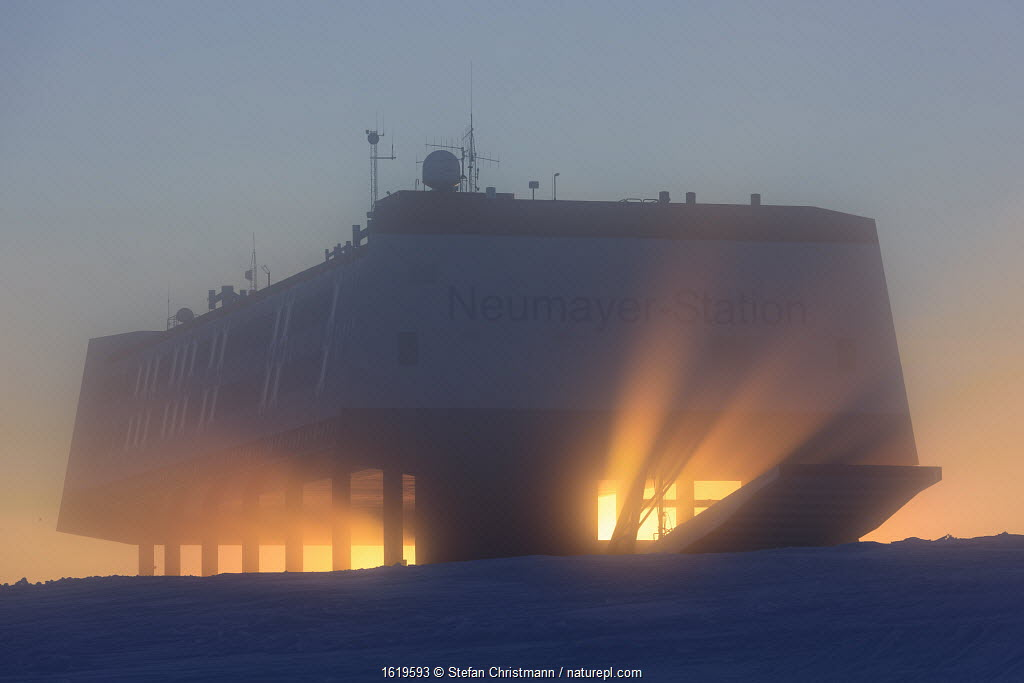 Sunset with beams of light shining through Neumayer-Station III, Alfred-Wegener-Institut research station. Atka Bay, Antarctica. January 2017.
