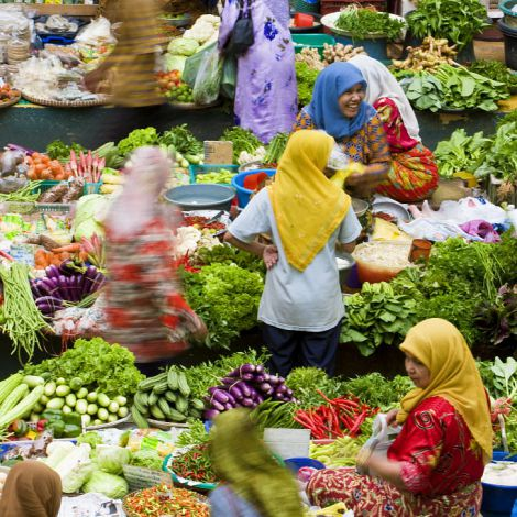 Women selling fruit and vegetables in the towns central market, Kota Bharu, Kelantan State, Malaysia 2008