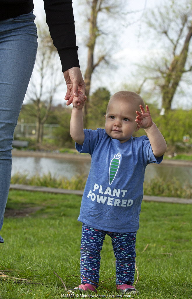 Baby girl in plant powered t-shirt. Model released.