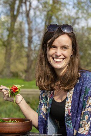 Woman enjoying a vegan picnic salad, North London, England, UK, March 2019. Model released.