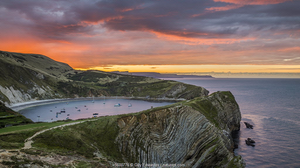 Lulworth Cove and Stair Hole at sunrise, West Lulworth, Dorset, England, UK. September 2015.