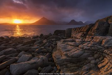 Sunset over the Cullin Mountains from Elgol shoreline, Isle of Skye, Scotland, UK, April.