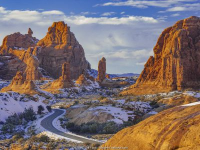 Winding road and sandstone formations, La Sal Mountains, Arches National Park, Utah