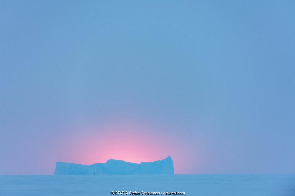 Sea ice and iceberg during polar night. Atka Bay, Antarctica. July 2017.
