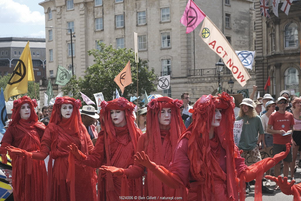 The Red Brigade performance artists on Extinction Rebellion climate change protest march. Bristol, England, UK. 16 July 2019.