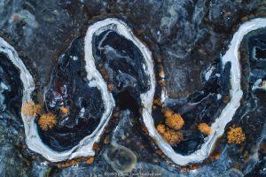 Frozen bends and flood plain of Halliste River, aerial view. Soomaa National Park, Viljandimaa County, Estonia. Febraury 2019.