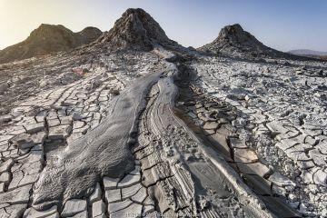 Mud Volcanoes and patterns of cracks in mud, Azerbaijan