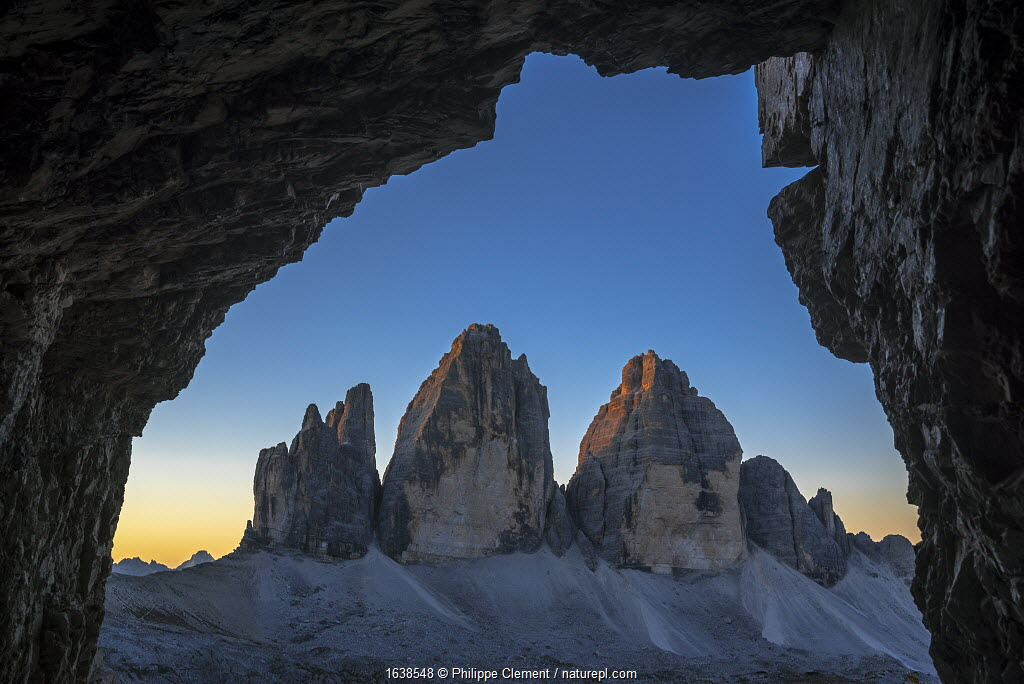 Tre Cime di Lavaredo / Drei Zinnen, three distinctive mountain peaks in the Sexten Dolomites seen from WW1 cave shelter, South Tyrol, Italy, October 2019