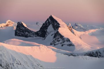 Sunset in the mountains, viewed from Loftet, Jotunheimen National Park, Norway, April.
