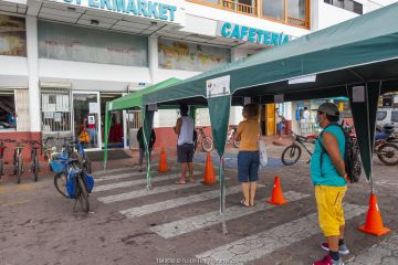 Queuing at the supermarket, normally crowded with tourists and locals, during Covid-19 lockdown. Puerto Ayora, Santa Cruz Island, Galapagos Islands April 2020