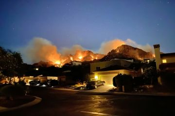 Wild fires on mountains behind homes, Arizona, USA, June 2020