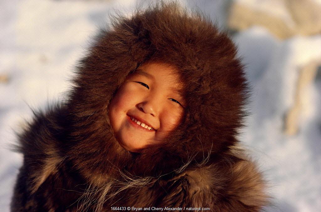 An Inuit girl, Sofie, warmly dressed in a fox fur hooded jacket (kapataq). N.W. Greenland. 1987