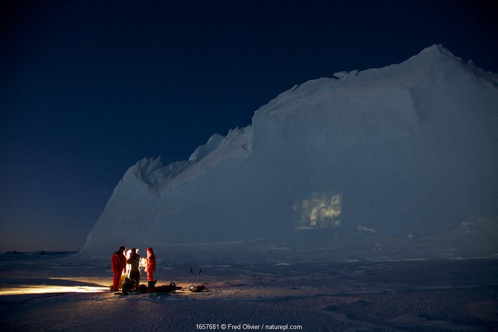 Film projection onto an iceberg, in the Antarctic mid winter. Antarctica June 2012