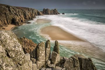 Logan Rock from Treen Cliff, Porthcurno, Cornwall.