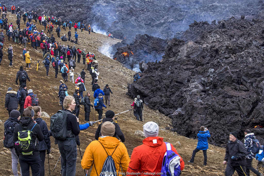 Large numbers of people, mainly from Iceland due to the Coronavirus pandemic, at the site of the eruption of the Fagradalsfjall volcano, Iceland, 2 April 2021.