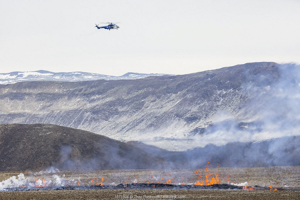 Helicopter hovering over the a new fissure that opened at April 5, 2021, about 700 meters from the original site of the eruption. 5 April 2021