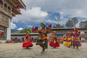 Gante Goemba Tsechu, festival dancers in monastery courtyard. Phobjika, Bhutan. September 2013.