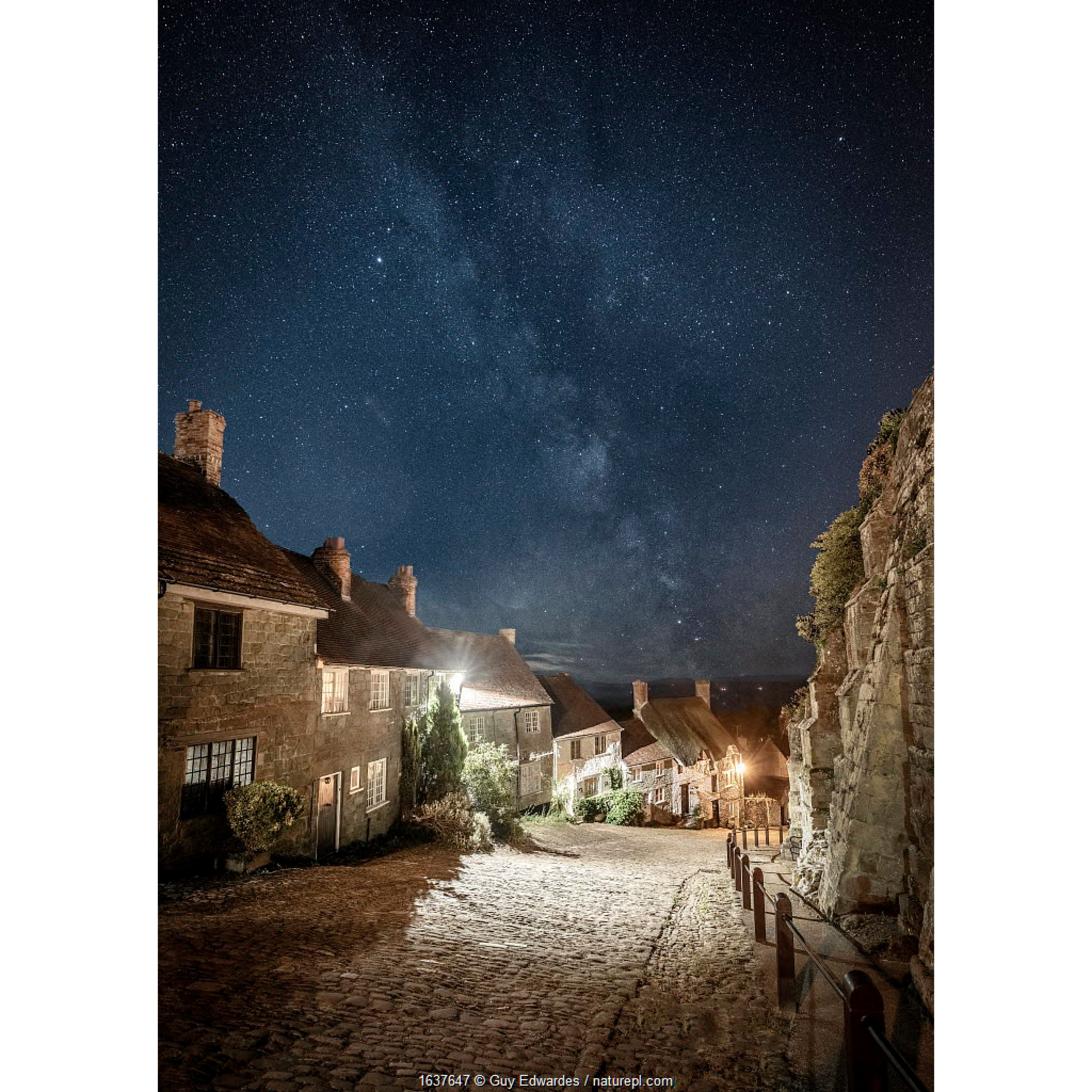 Gold Hill at night, with the Milky Way above, Shaftesbury, Dorset, England, UK, August 2018.