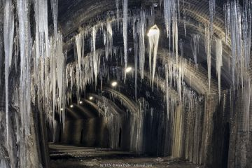 Tunnel along the Monsal Trail with a dramatic display of icicles during an extended period of freezing weather, Peak District National Park, Derbyshire, UK. February.