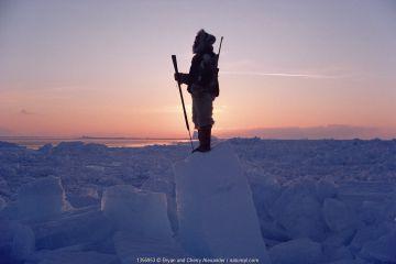 Inuit hunter scanning ice of Melville Bay for Polar bears. Northwest Greenland, 1986.