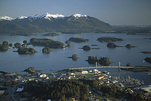 Aerial view of Sitka showing Spruce covered islands, downtown and the O'Connell bridge, Alaska - Michio Hoshino