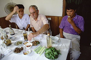 Herpetologist Ted Papenfuss tries snake meat at a specialty restaurant, Hanoi, Vietnam - Mark Moffett