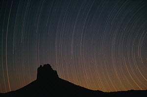 Startrails over Shiprock in four corners region, New Mexico  -  Tim Fitzharris