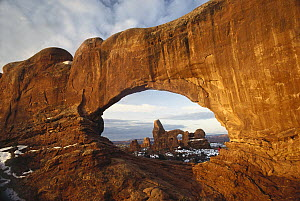 Turret arch through north window arch, Arches National Park, Utah - Tim Fitzharris