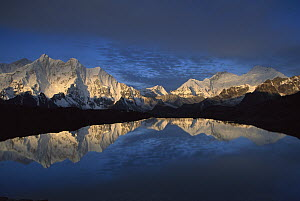 Panoramic view from Mt Makalu, elevation 8,462 meters, to Mt Everest, elevation 8,850 meters, at dawn, reflected in small lake, Khama Valley, Kharta region, Tibet  -  Colin Monteath