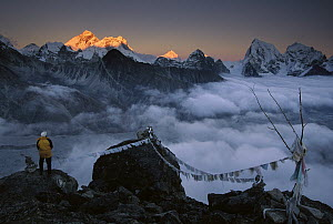 Mountaineer enjoying the view of Mt Everest and the Himalayan Mountains at sunset from Gokyo Ri, Khumbu, Nepal - Colin Monteath