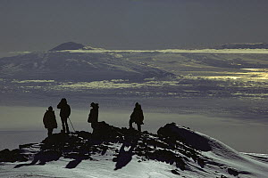 Scientists and field assistants view Mt Discovery from the summit of Mt Erebus, Ross Island, Antarctica  -  Colin Monteath
