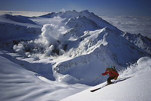 Skier descending Mt Ruapehu above active Crater Lake, Tongariro National Park, New Zealand  -  Mark Sedon