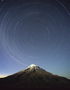 Star trails around the south celestial pole over Mt Taranaki, also known as Mt Egmont (8,261 feet) a dormant volcano in the southwest corner of the North Island near the Tasman Sea, Egmont National Pa...  -  Harley Betts