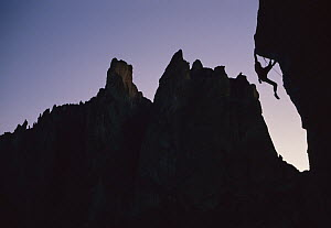 Climber silhouetted on Chain Reaction, a 5.12c route, Smith Rocks, Oregon  -  Lionel Clay