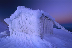 Ice encrusted Syme hut on Fatham's Peak, Mount Egmont National Park, New Zealand  -  Andy Reisinger